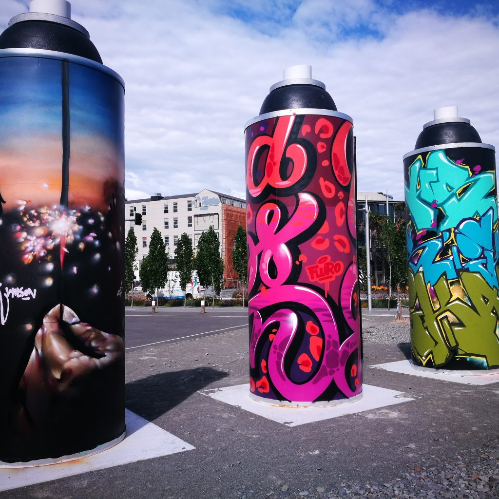 The Giant Cans got a make-over with new work by (L-R) Wongi 'Freak' Wilson, Fluro (Holly Ross) and Ikarus.
