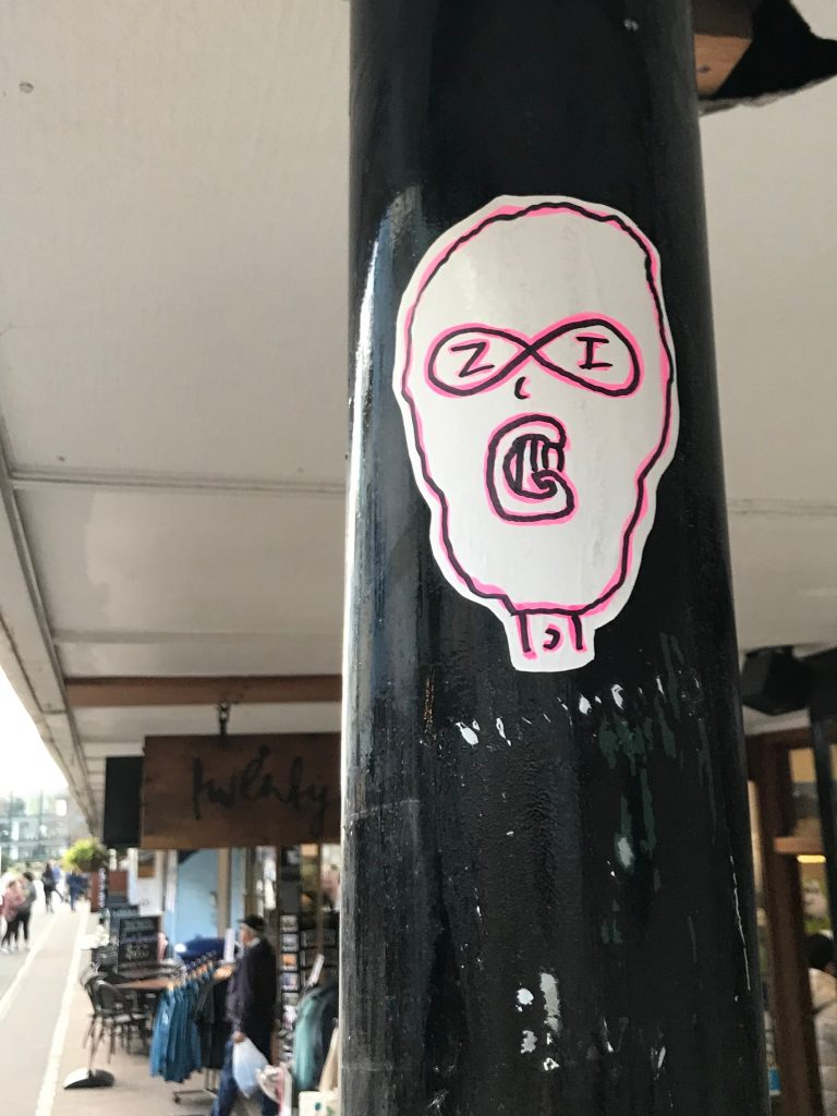 A hand drawn sticker by ZIG, featuring a ski mask wearing character.