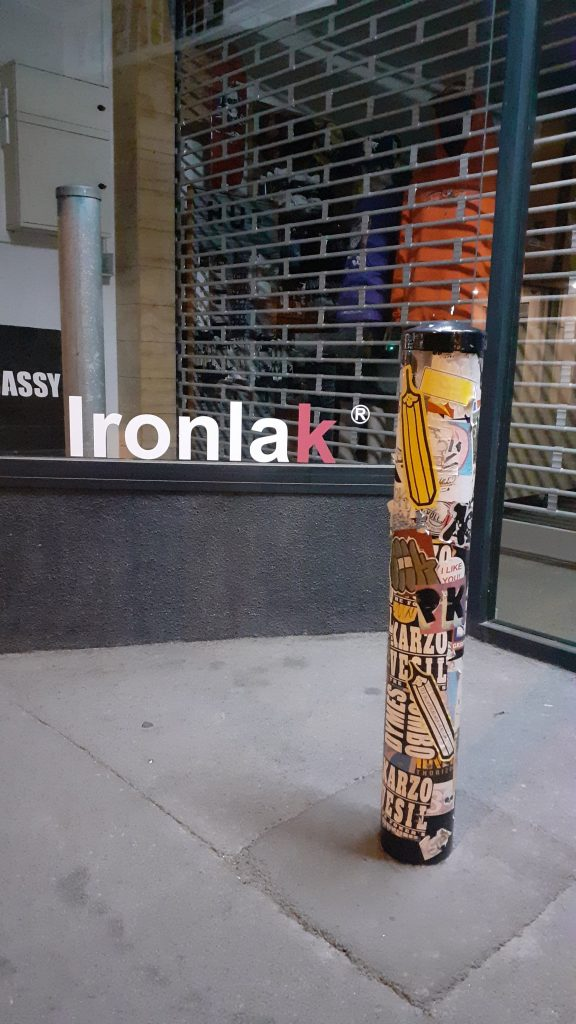 Stickers on a post outside a store in Christchurch