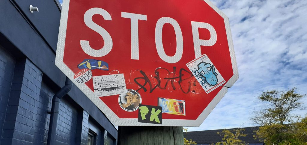 Stickers on a STOP sign in Christchurch