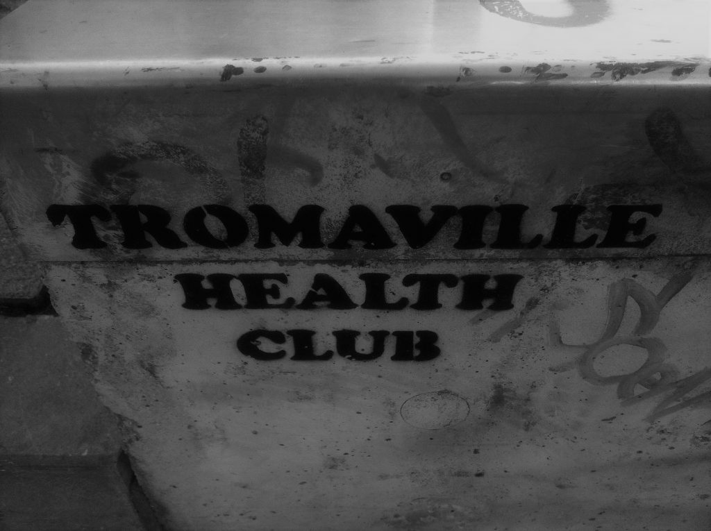 The words Tromaville Health Club, a reference to the trashy 1980s Troma films, is stencilled on a wall