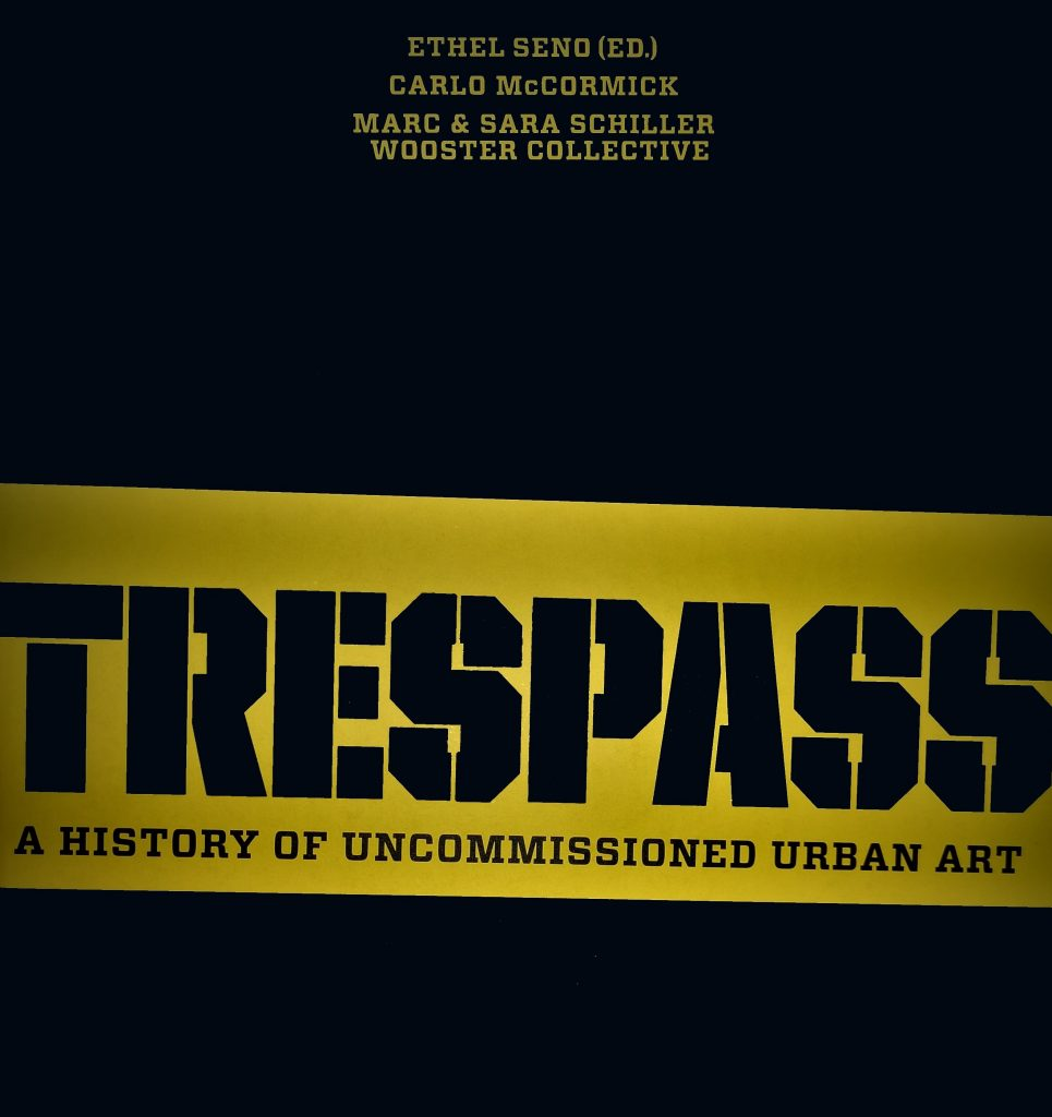 The cover of the book Trespass, featuring a yellow and black design and stencilled font