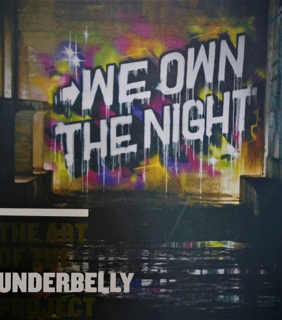 The cover of the book We Own the Night, featuring an aerosol painting of the title as par tof the Underbelly Project