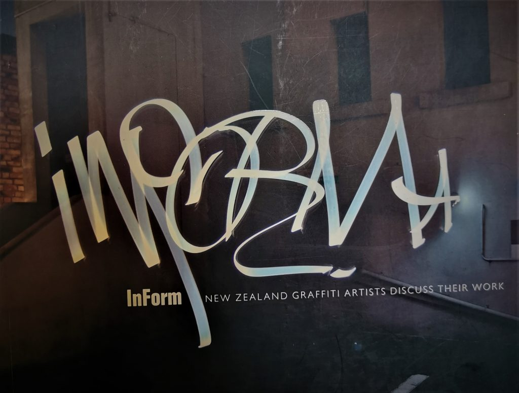 The cover of InForm, with the title written in light in an urban environment