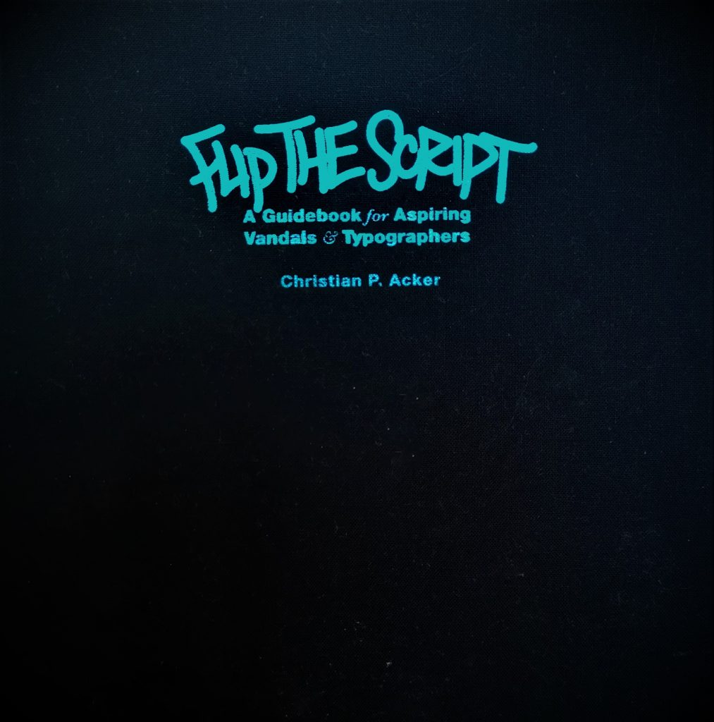 The black cover of the book Flip the Script with the title in blue