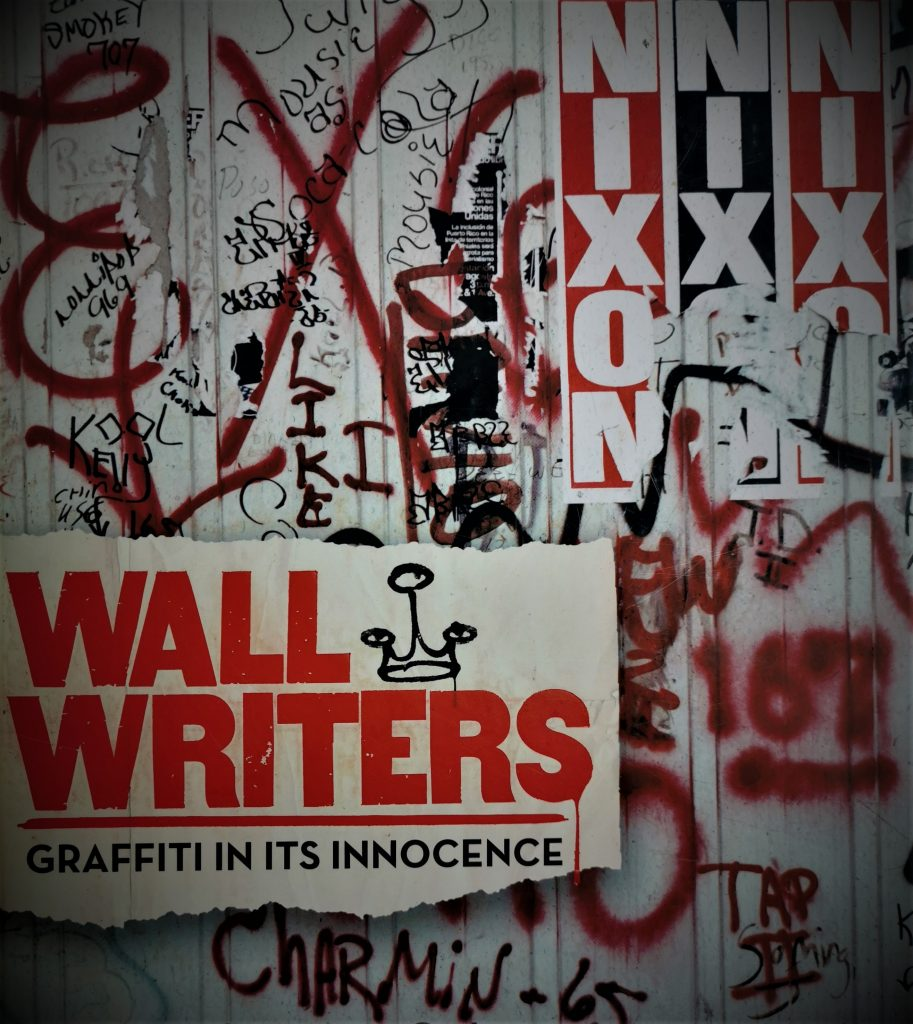 The cover of the book Wall Writers, featuring a 1970s wall heavy with graffiti and posters