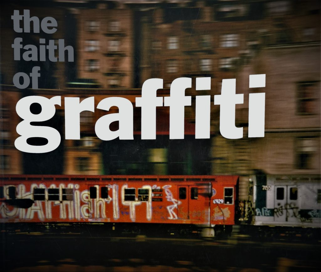 The cover of The Faith of Graffiti, featuring a graffiti-ed train in New York