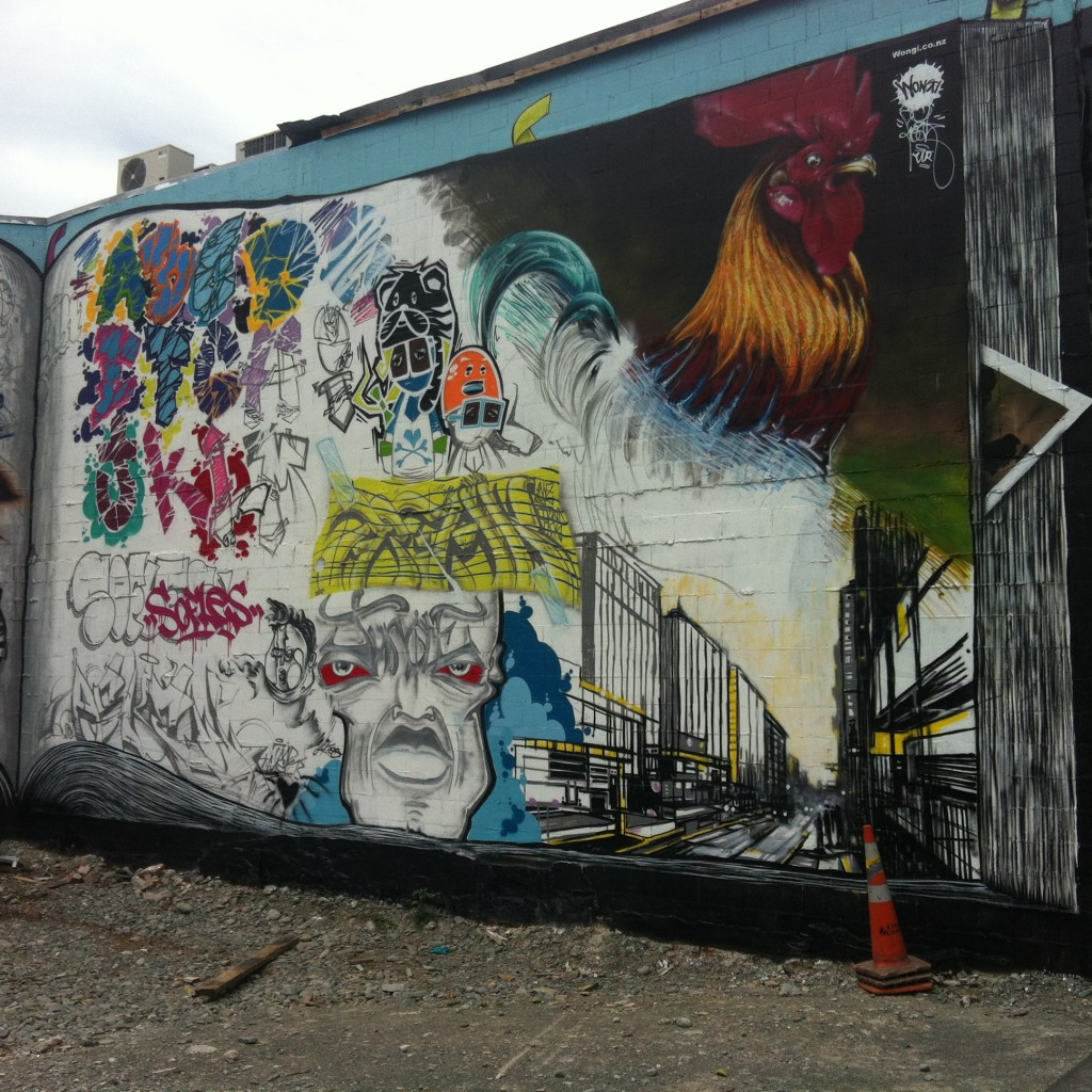 The 'Black Book' production co-ordinated by Ikarus and Freak for Rise in 2013. Located on the corner of Colombo and Hereford Streets, the wall featured the work of a number of artists, including Jungle's character and piece at the bottom centre.