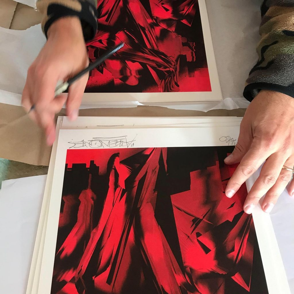 Askew One signs his MK Press x Fiksate collab risograph prints. (Photo credit: Elliot O'Donnell)