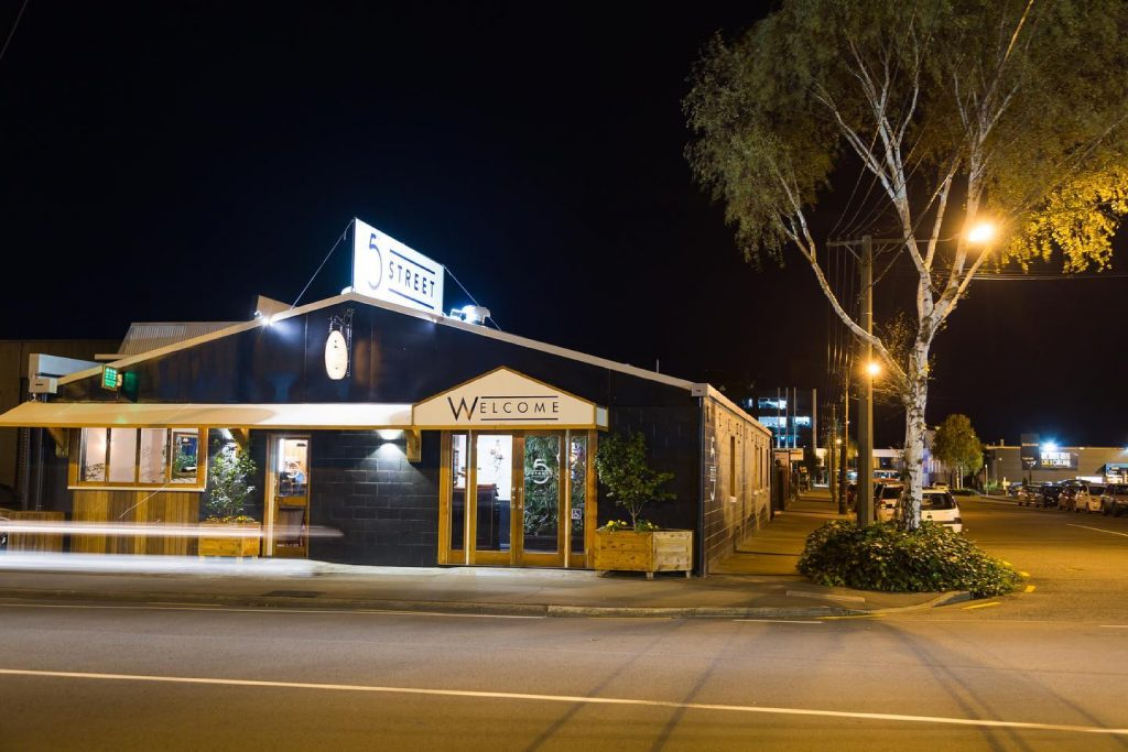 The restaurant 5th Street is photographed at night from outside.