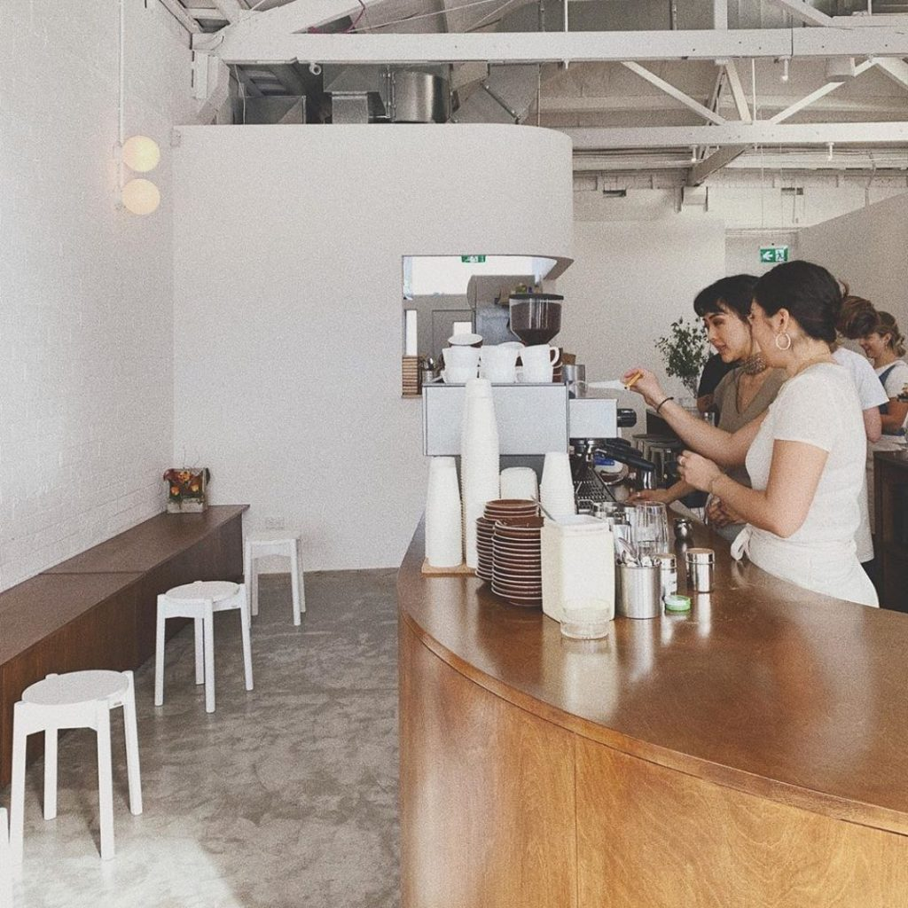 Some barista's prepare coffee inside the Child Sister cafe